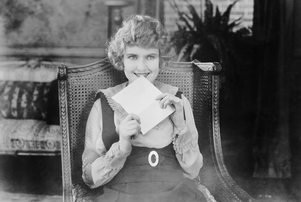 Excited woman with a letter | Mailchimp Top Tips